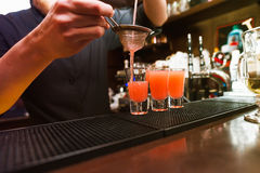 Barman stir alcohol. Process of preparing a cocktail royalty free stock image