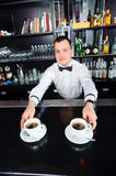 Barman stretches out coffee Stock Photography