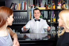Barman stretches out coffee Royalty Free Stock Photo