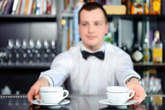 Barman stretches out coffee Stock Photo