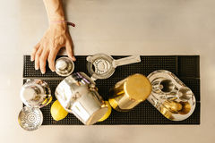 Barman takes tools for mix alcohol. Royalty Free Stock Photos