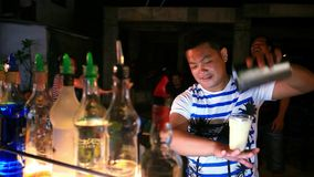 Barman to do a cocktail in night street on Koh stock video