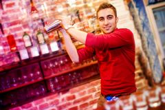Barman using a shake mixer cocktails and drinks in nightclub Royalty Free Stock Photography