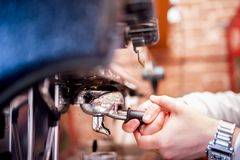Barman using a tamper and making espresso coffee Stock Photo
