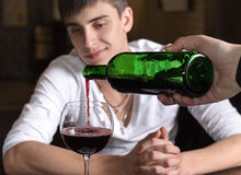 Barman or waiter pouring red wine Royalty Free Stock Photo