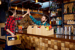 Barman and waiter work together with the team at the bar restau royalty free stock images