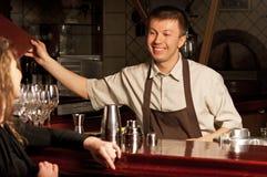 Barman at work. This is photograph of a barman at work stock image