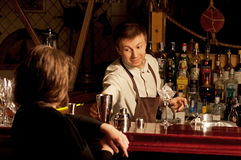 Barman at work. This is photograph of a barman at work stock photography