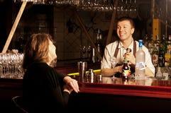 Barman at work. This is photograph of a barman at work royalty free stock photography