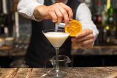 Barman at work, preparing cocktails. pouring pina colada to cocktail glass. Royalty Free Stock Image