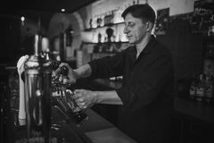Barman at work in the pub Stock Images