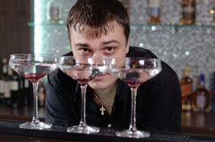 Barman working behind the bar counter royalty free stock photos