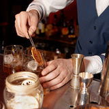 Barman works at bar counter Royalty Free Stock Photos