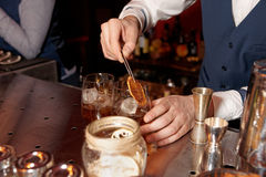 Barman works at bar counter Stock Images