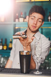 Barmans hands making alcohol cocktail Royalty Free Stock Images