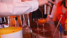 Barmen hand with shaker pouring cocktail stock video