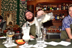 Barmen pouring a cocktail Stock Image
