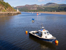 Barmouth Harbour in Snowdonia, Wales. Scenic view of Barmouth harbour on the estuary of the River Mawddach in the  Snowdonia National Park, with a boat in the Stock Photo