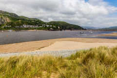 Barmouth wales uk. Coast at Barmouth wales uk with sand dunes estuary and bridge Royalty Free Stock Image