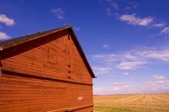 Barn 1. Side of an old barn against a cloudy sky Stock Photography