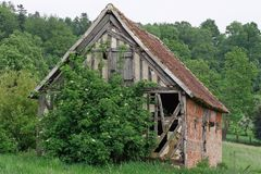 Barn. Ancient French derelict timber framed barn stock image