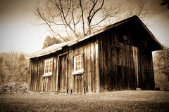 Barn. An old wooden barn with pitchfork on the wall Royalty Free Stock Image