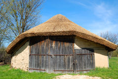 Barn. With thatch roof on sky background Royalty Free Stock Image