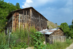 Barn. An abandoned old barn used to stockpile wood and hay Royalty Free Stock Photo