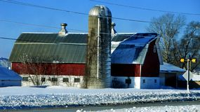 Barn along the road. This is a barn along the road in the country of a small town here in Wisconsin that milks cows Stock Photography
