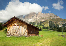 Barn in alpine meadow Stock Images