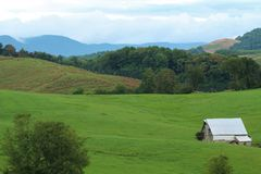 Barn in an Appalachian mountain field royalty free stock image