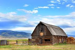 Barn Backed by Mountains Stock Images
