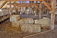 Barn Bales. Barn with straw bales on floor Stock Photo