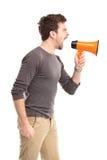 Man som ropar till och med megafonen Arkivfoto