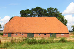 Barn. Big agricultural building, blue sky in background Stock Photo