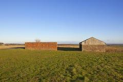 Barn and brick wall Royalty Free Stock Image