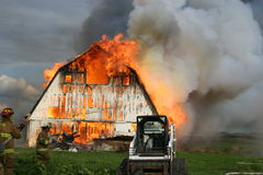 Barn building engulfed in flames. Burning barn building engulfed in flames out of control Royalty Free Stock Photography