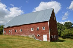 Barn bult into a hill Stock Photography