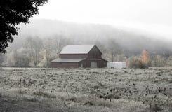 Barn caught in fog Stock Photography