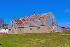 Barn with Cement Block Walls and a Metal Roof Royalty Free Stock Photo