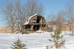 A Barn Collapsing in Winter Landscape Stock Photos