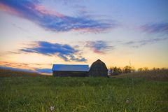 Barn in country at sunset Stock Photos