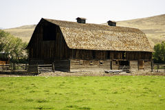 Barn in countryside. Exterior of large barn in countryside with hills and moors in background royalty free stock image