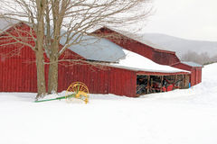 Barn and cultivator in snow, winter Berkshires MA Royalty Free Stock Photo