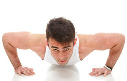 Barn danar sportmanen, kondition sommuskeln modellerar grabben övar   Arkivbild