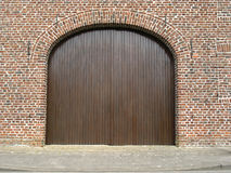 Barn door. Restored brick barn with wooden gate Stock Photography