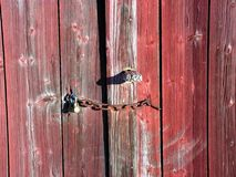 Barn door. A close up on an old barn door with a padlock Royalty Free Stock Photography