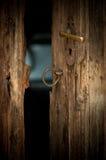 Barn door. An open wooden door of an old dark barn Stock Photos