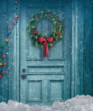 Barn door with Christmas wreath Royalty Free Stock Photos