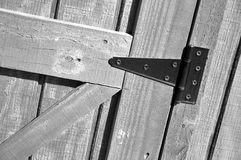 Barn door with hinge in black and white Royalty Free Stock Photo